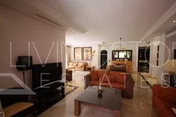 Beautiful and bright ground floor apartment with ample terrace giving access to pool and ...