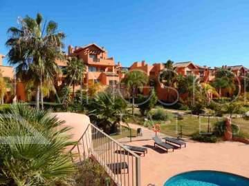 Three bedroom ground floor apartment in gated complex close to golf course and the beach, ...
