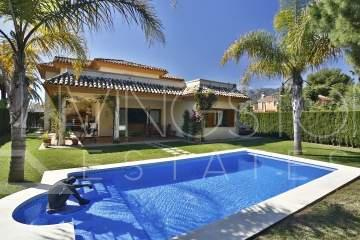 RIO REAL: South facing 4 bedroom villa in small gated community. Only five minutes' drive to ...
